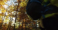 Hiker walking with poles and backpack at the sunset autumn forest Stock Footage
