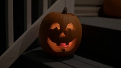 Pumpkin Jack o Lantern on Door Step. Stock Footage