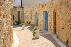 The narrow street in the old part of Malia. Stock Photos