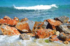 Rocks on the coast of Aegean Sea. Stock Photos