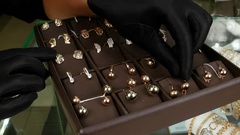 Gold jewelry for women, exposed for sale in a jewelry store, Jeweller puts gold Stock Footage