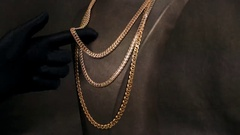 Jewellery shop, exhibition of jewelry, a gold chain for the neck is in Stock Footage