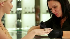 Jewelry store, Golden Ring with Diamonds, Happy woman talking with smiling Stock Footage