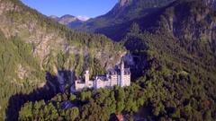Romantic fairytale disneyland inspiration Neuschwanstein castle aerial motion Stock Footage