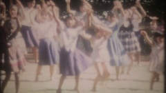 Young Hawaiian girls learn to Hula dance in park, 3756 vintage film home movie Stock Footage
