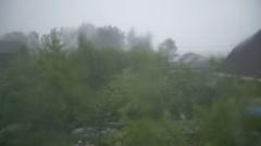 Heavy rain outside the window goes Stock Footage