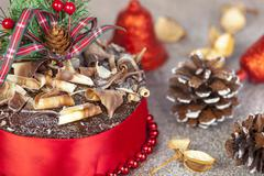 Chocolate christmas cake with twirl topping and red ribbon Stock Photos