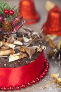 Chocolate christmas cake portrait with twirl topping and red ribbon Stock Photos