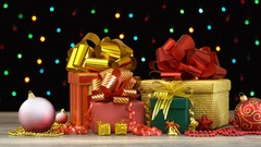 Beautiful Christmas gift boxes and decorations on a wooden floor Stock Footage