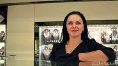 Jewelry store, Girl seller at a jewelry store in a black dress, jewelry Stock Footage