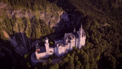 Aerial rotating motion Neuschwanstein castle mountain forest landscape sunny day Stock Footage