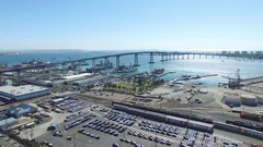 San Diego Wide Aerial Shot of Coronado Bridge and the Dock with Boats Stock Footage