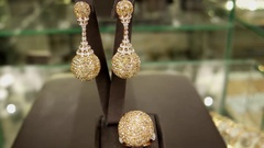 Expensive jewelry for the rich and famous women on the counter, earring, ring Stock Footage