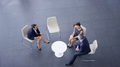 4K Overhead view business group meeting in large modern office building Stock Footage