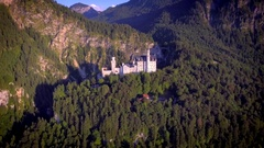 Aerial famous Neuschwanstein castle landmark touristic mountain forest Stock Footage