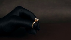 Jewelry, Demonstration of a gold ring with a diamond, jewelery sold in the Stock Footage