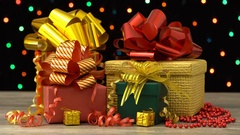 Beautiful Christmas gift boxes and decorations on a wooden floor. Stock Footage