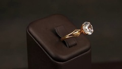 Jewelry, Big expensive gold ring with a huge diamond rotates on the stand, gold Stock Footage