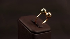 Jewelry, Beautiful gold ring with light rotates on the stand, jewelery sold in Stock Footage