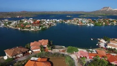Aerial overview shot of houses, islands and boats at Spanish Water in Curacao Stock Footage