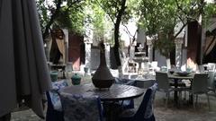 Quiet garden empty restaurant patio in Morocco Stock Footage