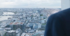 4K Successful London business manager looking out of window at view of the city Stock Footage