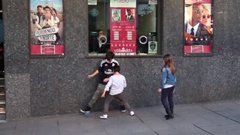 Siblings kicking a can around Stock Footage