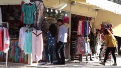 Street vendor fixing up stall Stock Footage