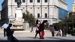 Mickey and Minnie Mouse outside Royal Palace of Madrid Stock Footage