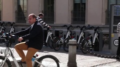 Man renting a bicycle Stock Footage