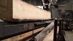 Timber mill. View of log moves with cut to camera Stock Footage