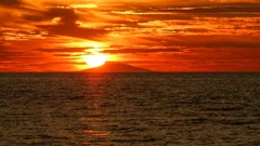Time lapse - Colorful red sunset over the sea Stock Footage