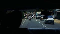 Streets of Sri Lanka from a minibus in Kaluthara with driver Stock Footage