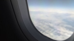 Hand of plane passenger shutting window shade to have rest during long flight Stock Footage