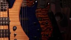 Close up CU pan bass guitars body Stock Footage