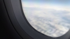 Hand of passenger opening window shade before landing, flight safety measures Stock Footage