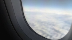 Nervous person suffering fear of flying shutting and opening plane window shade Stock Footage