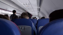 People on board of low cost airline plane, cheap flight tickets booking service Stock Footage