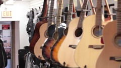 Pan acoustic guitars on wall Stock Footage