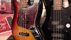 Pan rack focus row of bass guitars Stock Footage