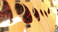Rack focus row of acoustic guitars Stock Footage