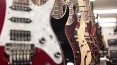 Rack focus row of guitars close up Stock Footage