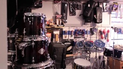Wide shot pan drum room in music store Stock Footage