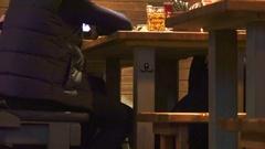 Men enjoy beer at the pub Stock Footage