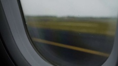 Airplane moving along runway after successful landing at airport, flight phobia Stock Footage