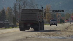 Highway traffic, logging truck enters highway Stock Footage