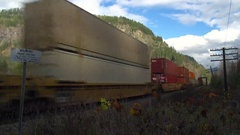 Railroad, container train, inter-modal, eastbound over bridge, medium wide shot Stock Footage