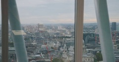 4K Business manager in London office using tablet & looking out at view of city Stock Footage