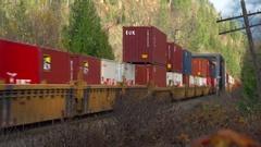 Railroad, container train, inter-modal, eastbound over bridge, medium shot Stock Footage