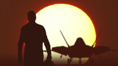 F22 fighter pilot walks against sunrise Arkistovideo